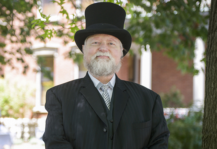 Photograph of Harrison reenactor, posing in front of the mansion.