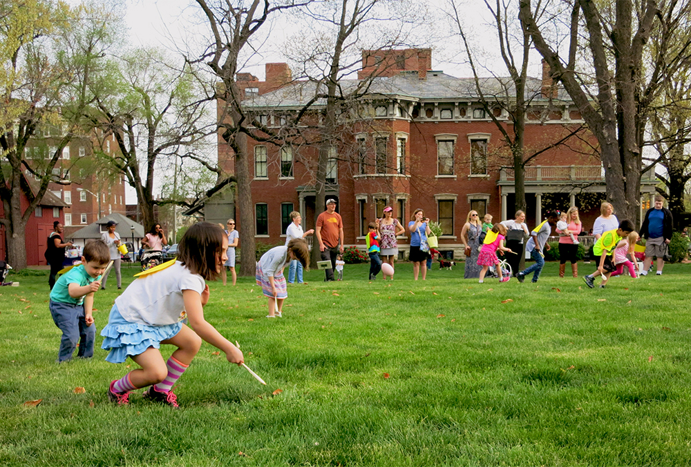 Photographic image of lots of kids on the lawn of the presidential site.