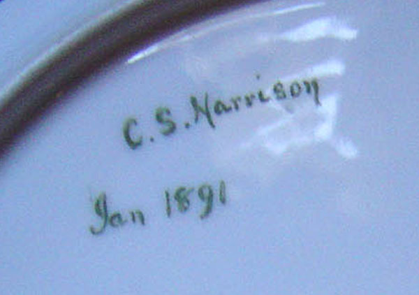 Bottom of the ribbon plate, signed