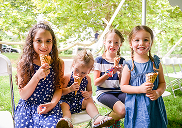 photograph of a group of young girls photographed at a benjamin harrison presidential site event, each eating an ice cream cone on a warm summer's day.