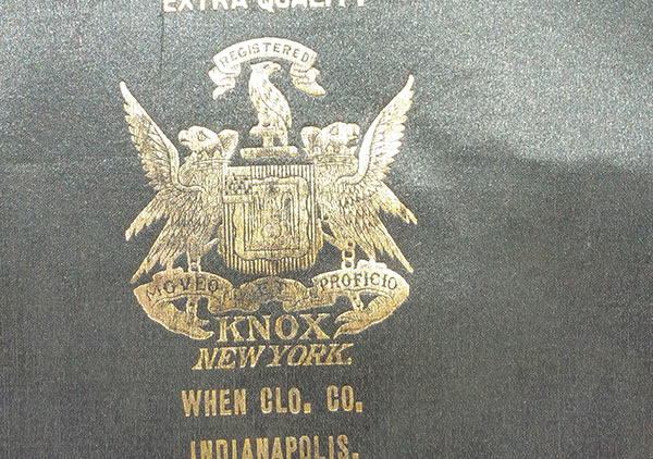 imprinted in gold inside on the top is 'Extra Quality centered over a mark/symbol – the word Registered on banner over a bird with wings next to body, which is over a shield with a bird on each side with wings extended sitting on a banner/ribbon with the words Moveo et Proficio printed; the word KNOX is under the banner; New York on the line beneath; under the shield on two lines is 'When Col. Co. Indianapolis.'