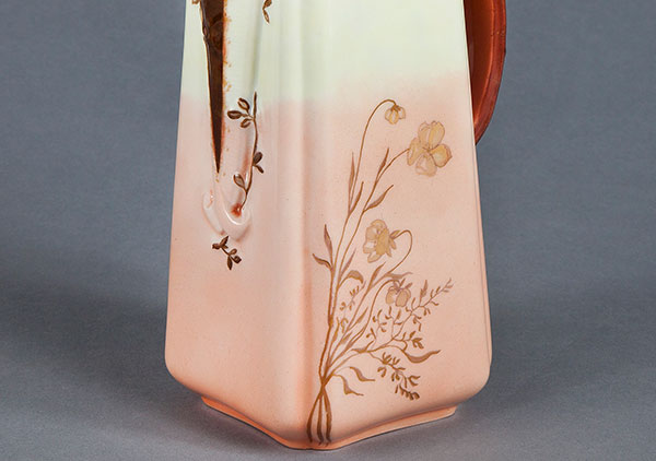 Photo of Square pot with pink and rose colors blended into cream and white upper part, gold butterflies, brown handle & spout. Initials