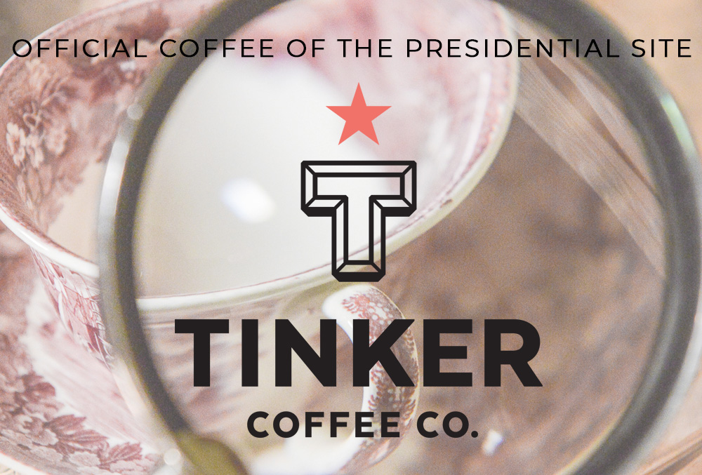 Photograph of china and a magnifying lens. Text reads: Official coffee of the Presidential Site, Tinker Coffee Co.