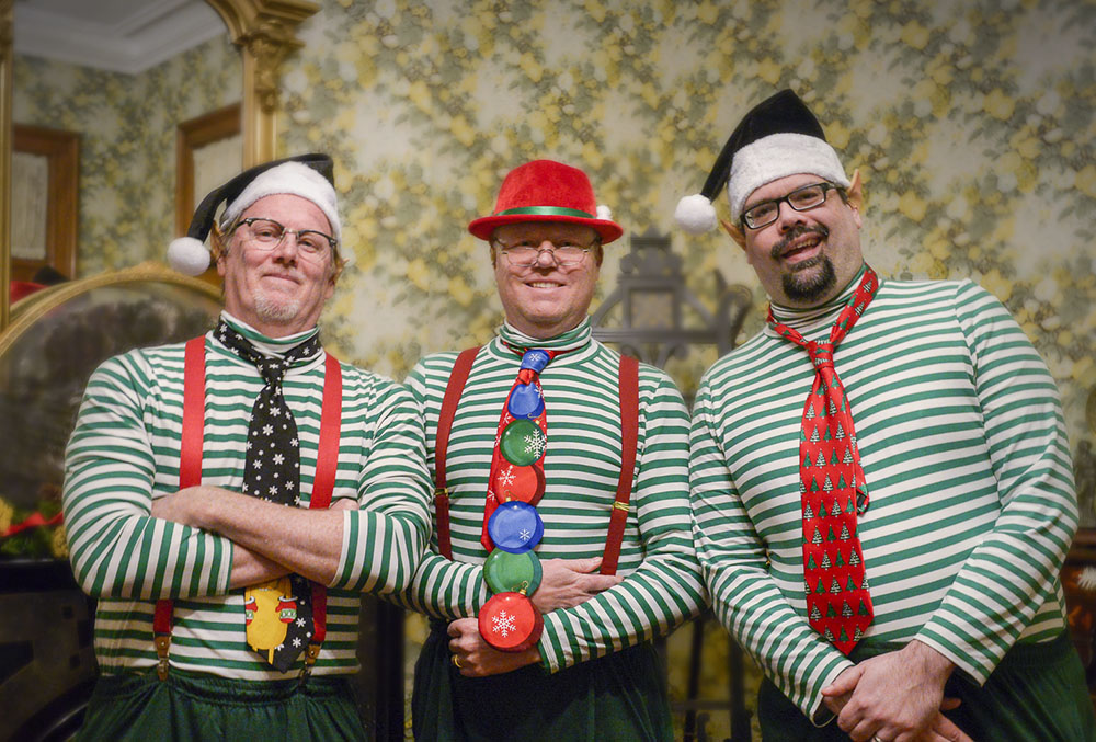 photo of three men dressed as elves in the benjamin harrison home.
