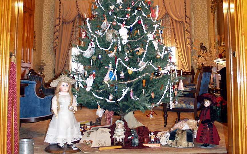 Photo of parlor featuring decorated christmas tree and ornaments.