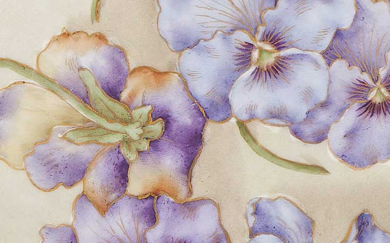Designed and hand-painted by Mrs. Caroline Scott Harrison with hand painted purple and lavender Pansies. Edge is a cutout lace pattern with gold paint.
