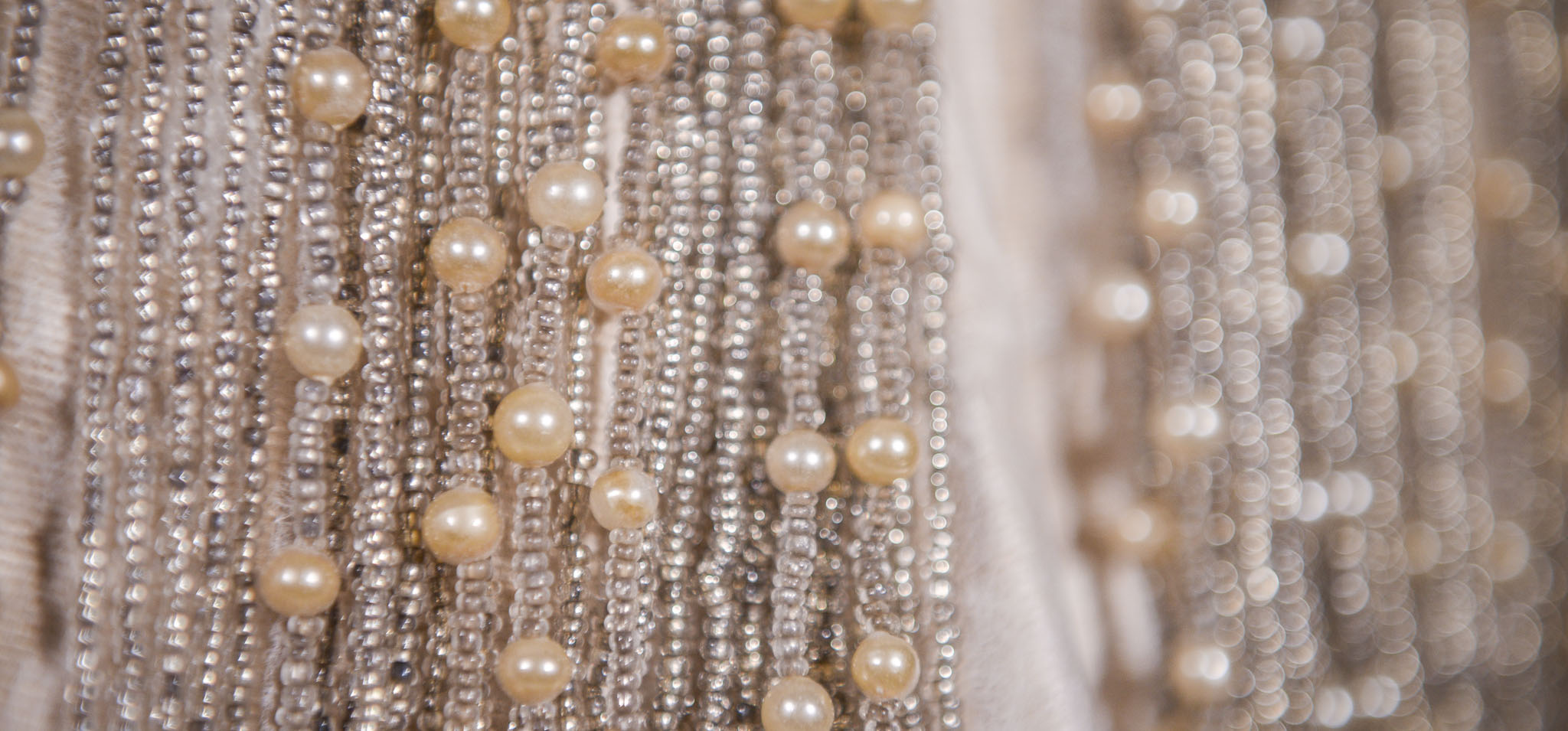 Photographic image of lots of strings of pearls and beads.