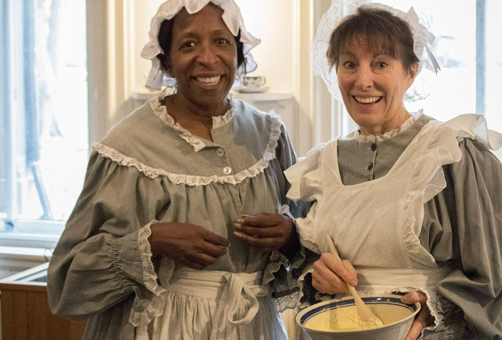 Photographic image of two women dressed as 19th century cooks.