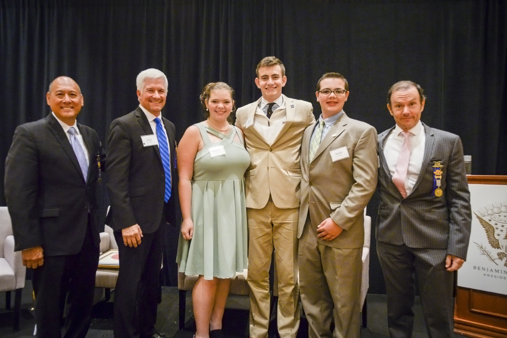 photograph of a group of visitors gathered, smiling for a photo at the mary tucker jasper speaker series.