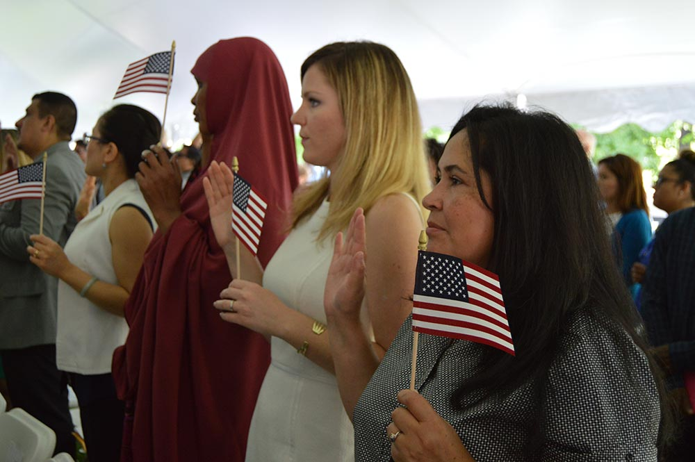 Photograph of women of different nationalities taking the oath of American citizenship.