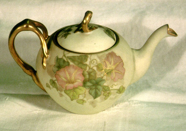 Three piece set plus companion Orchid tray. Tea pot, sugar, and creamer all hand-painted with morning glories by Mrs. Caroline Scott Harrison in pastel tones, green leaves and gold trim. Tea pot and sugar bowl have lids and gold twig like handles. The Orchid tray is done in matching tones and style.