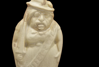 Ivory colored flask that depicts Teddy Roosevelt wearing sash that says
