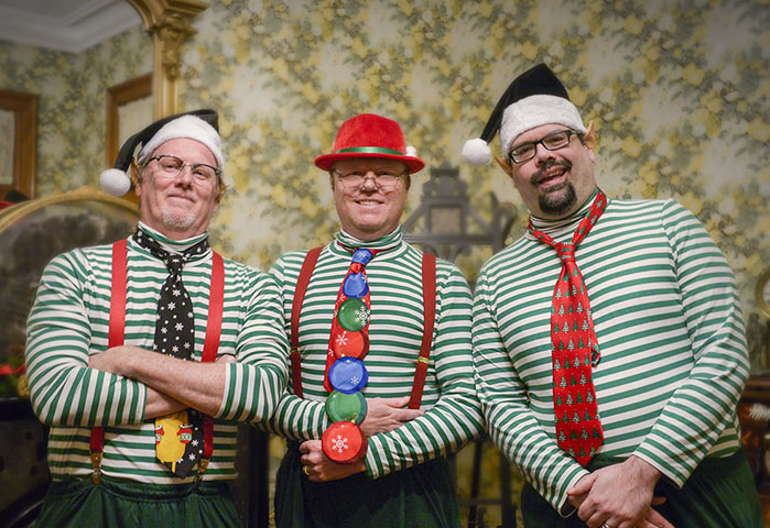 Photograph of Candlelight Theatre actors dressed as elves.