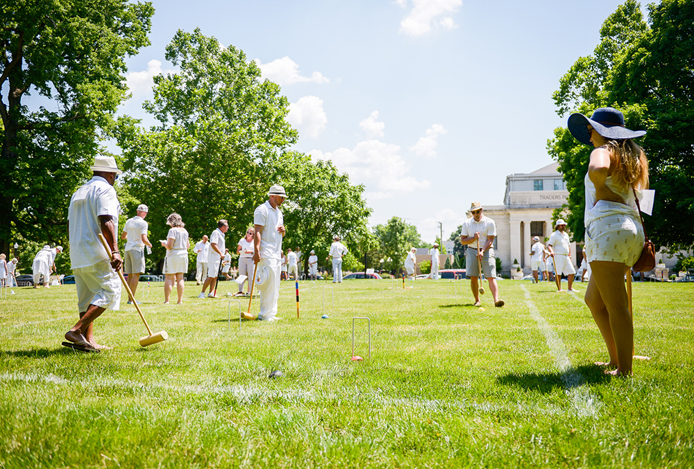 Photographic image of people playing croquet