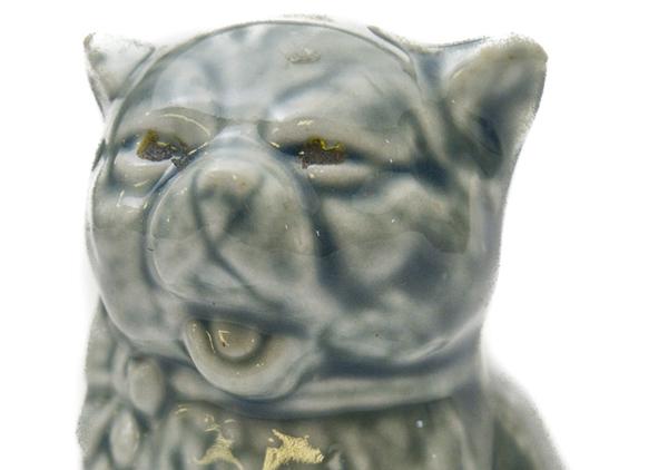 Cat figurine that says