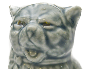 Cat figurine that says