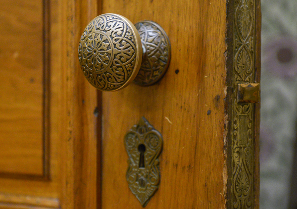 Ornate Victorian door knob at the Benjamin Harrison Presidential Site. The door knob is engraved with an intricate pattern featuring detailed curves and shapes.
