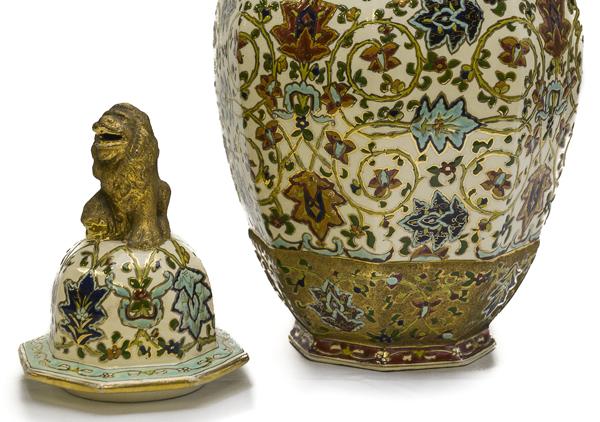 Matched pair of porcelain rose jars (Potpourri jars) with octagon shape, so called as they were filled with dried rose petals. They are Hungarian and have a gold lion on top. The lions are painted with a rough finish gold paint. They have their mouths open and one paw up on a bright and smooth gold ball. Ornately painted with red, blue, and dark yellow flowers with green leaves and vines on white background with gold trim at top.