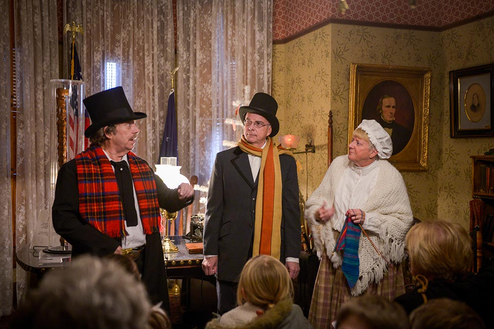 photo of three candlelight theater actors performing in benjamin harrison's office.