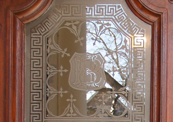 Victorian front door and etched glass of the Benjamin Harrison Presidential Site 1875 Italianate style home. Etched glass was a