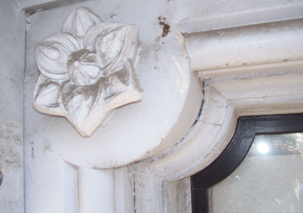 Architecture rosettes from the frieze band area of the house made of zinc. The Italianate house was built in 1874 - 1875.